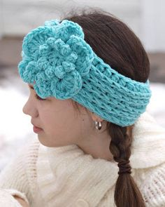 Crochet Ear warmer with flower.just 2 strands WW yarn held together with an N hook. Ch 38 and join.then HDC in back loops only for 6 rounds and tie off. Add flower of choice. Crochet Crafts, Crochet Yarn, Yarn Crafts, Crochet Stitches, Crochet Headbands, Kids Headbands, Love Crochet, Learn To Crochet, Crochet Flowers