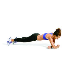 Pumped-Up Planks Whittling Walk      Start in plank, then bend elbows to bring forearms to floor; move right hand to left elbow and left hand to right elbow. Lift right arm over left, placing it in front of left on floor (as shown), as you walk toes 1 step forward. Repeat with left arm, then reverse move to return to start, for 1 rep. Repeat.
