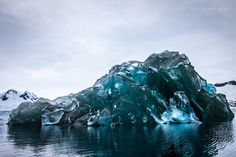 Photographer captures rare, breathtaking images of recently flipped iceberg