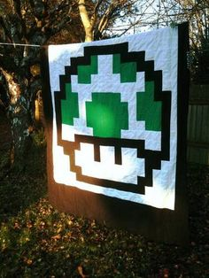 I am in Love with this pixel quilt, It may just be my summer project. Though i first need to learn to quilt
