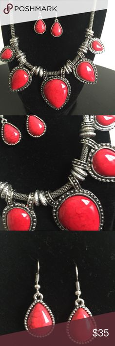 NEWThe Rio Red Statement Necklace Set Red is the color of passion and love and that is what message this necklace set sends when you wear it! Beautiful red gems set in silver metal make a statement without having to say a word! 15-18 inches with adjustable closure. Matching earrings complete the set. Jewelry Necklaces