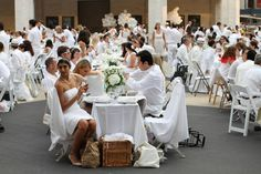 Reports from major news outlets, the event at Lincoln Center tonight was not an extraterrestrial welcoming ceremony. It was the Diner en Blanc-- a self-described 'tres-chic' flashmob feast which began in Paris. Every year, the feast's location is announced immediately before the event. With a waiting list of 30,000 people, the event is roped off from the public and very difficult to get into. Unless you run across the street and buy a $30 white collared shirt from Century 21, with Ciutea…