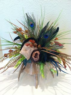 Deer Antler Arrangement with burlap & peacock feathers by Greatwood Floral Designs.