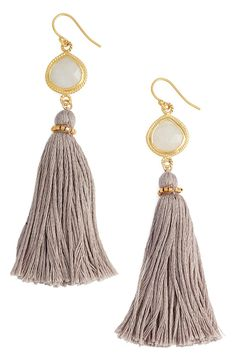 Faceted baubles framed with milgrain trim top these bohemian-chic drop earrings that softly sway when walking.