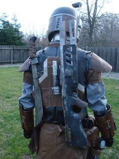 Mandalorian Merc with a slugthrower shotgun and machete
