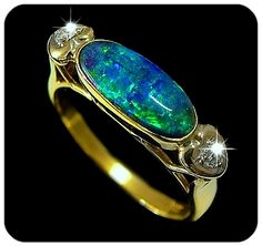 Brilliant Green Blue Black boulder Opal set in 18k yellow Gold with diamonds