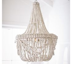 Whitewashed wood beads give the Francesca Chandelier a fresh, summery look. Whether in a dining room or a seating area, it's a natural complement to any decor style. Chandeliers, Shell Chandelier, Rectangular Chandelier, Wood Bead Chandelier, Chandelier Bedroom, Chandelier Lighting, Coastal Chandelier, White Chandelier, Pottery Barn Chandelier