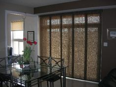 Roller shades on a sliding glass door indoor home decor for Panel tracks for patio doors