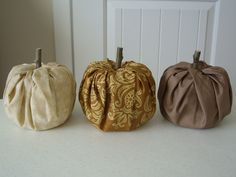 Such a cute idea. Fabric pumpkins!lay out your fabric & place toilet paper on top. Tuck fabric into the middle of the toilet paper roll and stick a rolled up paper bag in the middle for the stump. cut little leaves out of a green fabric and just throw it on there.