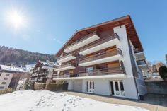 """Lovely Building located in the Nendaz Resort Center in Valais. Picturesque View of Swiss Alps while Staying next to the Ski Slopes of the Huge Ski Area Vallées"""". See more on our Website. Contact us for Further Information. Ski Slopes, Us Real Estate, Swiss Alps, Switzerland, Skiing, Highlights, Mountains, Mansions, Website"""