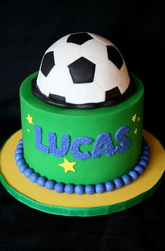 Soccer Ball without grass on tall base cake with writing on the side