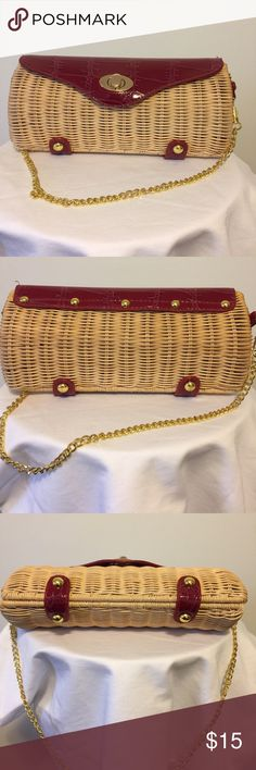 """Straw Clutch with detachable metal strap Perfect for an evening out. Strap can be used for arm carrying or taken off and purse carried as a clutch. No stains, flaws or defects. Measures 10"""" long, and @ 2.75"""" wide. Opens to 4.5"""" wide. Strap is 21.5"""". Clutch is about 4.5"""" high. Fully lined and inside pocket. Bags Clutches & Wristlets"""