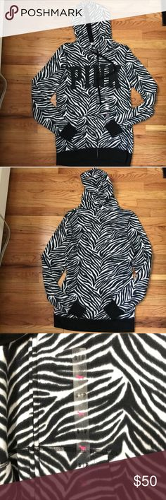NWOT VS PINK Zebra Print Zip Up Hoodie Small NWOT VS PINK zip up hoodie. Size small but runs bigger. Zebra printed. HTF. PINK Victoria's Secret Tops Sweatshirts & Hoodies