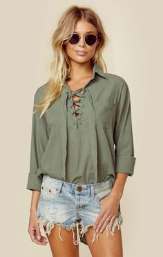 Faithfull The Brand's Hutton Shirt is a relaxed tunic style top with a lace up front and asymmetrical hem. Pair with a straw hat and denim cutoffs for an effortless beachy style.