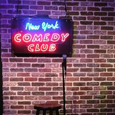 Performing standup comedy at The New York Comedy Club