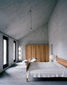 This modern Underground home by Bearth & Deplazes is not completely underground but more of a cavern. I am drawn to homes with exposed concrete walls Concrete Bedroom, Concrete Interiors, Wood Bedroom, Concrete Walls, Concrete Ceiling, Bedroom Decor, Wall Decor, Style Loft, Concrete Architecture