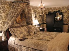 Toile de Jouy  RMS user toogerbug used black and cream toile to create a modern-day French country getaway. The toile bed crown coordinates well with the matching bedding and wallpaper without losing its dramatic appeal.… more