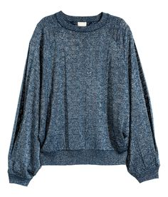 Blousy blue sweater with glittery thread, long sleeves, and arm slits. | Warm in H&M