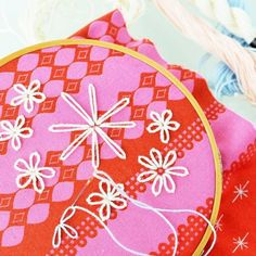 Step-by-step picture guide on how to embroider flowers using the Detached Chain Stitch, also known as the Lazy Daisy Stitch