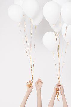 white balloons + gold ribbons