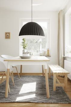 beautiful sunlight on white and wood with a hint of black - this would fit right into a Japanese home too