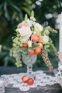 Elegant centerpiece for late summer garden of country club wedding - floral and fruit arrangement of Renaissance charm