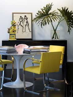 via cush and nooks:  Tulip table with yellow chairs.  LOVE these chairs
