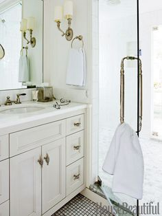 Etoile faucet has ebony handles for a little heft. Twisted pulls from LB Brass.