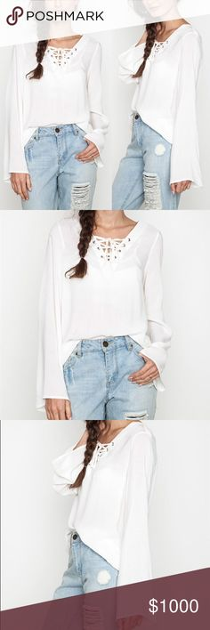IN STOCKFavorite Lace Up Bell Sleeve Top This top is so chic and stylish! Super easy to style for many occasions. Made out of nice, soft and comfortable fabric!  Available in Ivory, Blush and Sage.  Material: 70% Cotton, 30% Polyester. Wild Dreams Tops