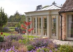 timber orangery with plants