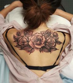 A first tattoo, this lovely back piece of roses by tattoo artist Nhia Yang.