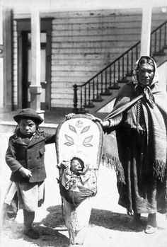Salish woman named Mrs. Ninepipes and her children, Montana