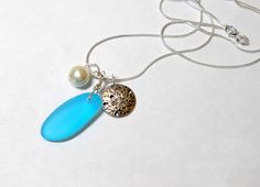 Aqua Blue sea glass pendant necklace by BethExpressions, tropical jewelry, sterling silver plate chain, silver sand dollar, cultured pearl by BethExpressions on Etsy