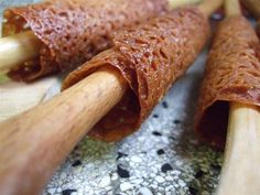 brandy snaps minus the brandy.  You fill them with cream (whipped, bavarian, whatever).  They are delicious!