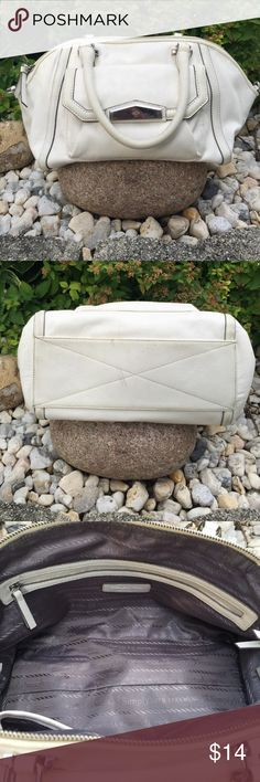 White Handbag Gently used Vera Wang handbag is in good condition.  It comes with a shoulder strap (pic 4).  It has a little discoloration underneath  (pic 2). Vera Wang Bags Totes