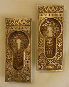 """#6788H  Pair of cast bronze Aesthetic pocket door pulls.  2 1/8""""W x 5 1/4""""H  ca.1885"""