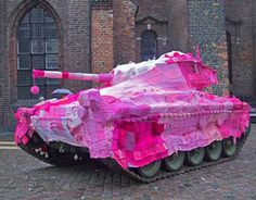 Guerilla Knitting/ Yarn Bombing done on this tank in Copenhagen, Denmark. Freaking Awesome!