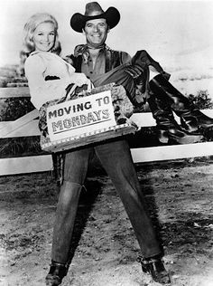 THE BIG VALLEY (ABC-TV) - Peter Breck holds Linda Evans in his arms for the announcement of a schedule change for the series.