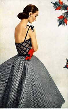 Evelyn Tripp in party dress of tiny black and white checks with bodice covered in lattice work of black velvet, Harper's Bazaar, May 1952
