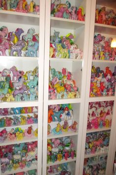 Erica's fantastic My Little Pony collection in white BILLY bookcases - I wonder where she got her risers? My hubby's a miniatures collector and would love this setup.