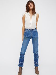 Heirloom My Thai Jean | Made from hand selected vintage denim featuring original distressing and natural wear and tear, these boyfriend fit jeans feature beautiful embroidery detailing.   *Authentic, non-stretch denim.  *Five-pocket style.  *Button fly.  *Due to the use of vintage materials each pair will vary slightly.
