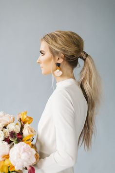 Modern sleek low ponytail hairstyle: Photography : Kenzie Victory Read More on SMP: http://www.stylemepretty.com/2017/01/05/all-the-inspo-you-need-to-infuse-your-wedding-with-modern-romance/