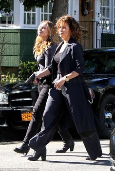 Women in arms: JLo was seen filming scenes with former Sopranos star Drea de Matteo in matching dark outfits and heeled ankle boots