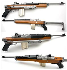 Ruger Mini 14, in stainless steel with a factory original folding stock
