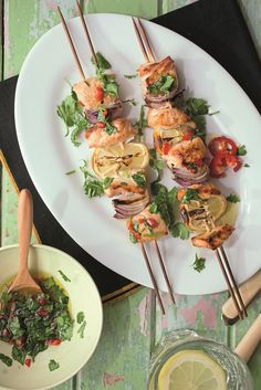 Grilled salmon kebabs with a chilli herb dressing. These spicy and delicious salmon kebabs are the perfect fish dish for your summer BBQ party. Image and recipe by Anna Pettigrew. Bbq Party, Grilled Salmon, Kebabs, Summer Bbq, Fish Dishes, Fruits And Vegetables, Coriander, Herb, Spicy