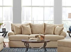 This sofa is a great way to relax and unwind after a long day.  It includes 2 throw pillows.
