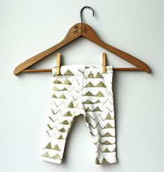 Hand Printed Organic 'Mountain' Baby Leggings in Gold on Creme