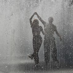 dancing in the rain... but im guessing that's fake rain b/c it's falling in perfect lines.