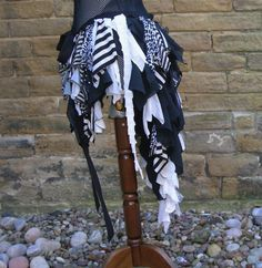 Black and white badger bustle with leaf and lace trim. Steampunk, pirate, pixie, festival clothing or tribal belly dance costume over skirt