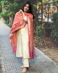 Shop online Beige cotton silk kurta set with chanderi Benarasi dupatta - Set of three Beige cotton silk kurta set. It comes comes with mirror work on the kurta sleeves and base of the pants. The set is paired with a chanderi Benarasi dupatta. Silk Kurti Designs, Salwar Designs, Kurta Designs Women, Kurti Designs Party Wear, Benarasi Dupatta, Silk Dupatta, Silk Anarkali Suits, Chanderi Suits, Churidar